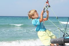 Boy on board of sea catamaran Royalty Free Stock Photography