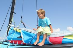 Boy on board of sea catamaran Royalty Free Stock Photos