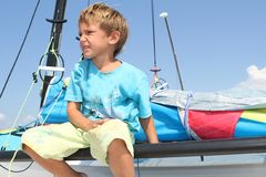 Boy on board of sea catamaran Stock Image