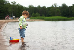 A boy with a boat stock photos