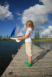 Boy with boat Royalty Free Stock Photo