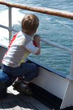 Boy in boat royalty free stock image