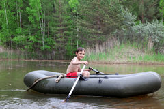Boy in boat Stock Image