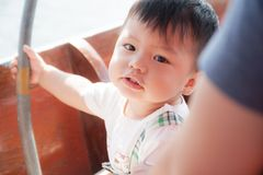 The boy in the boat Stock Photography