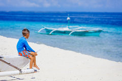 Boy in boat on the beach Royalty Free Stock Photography