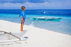 Boy in boat on the beach Royalty Free Stock Image