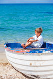 Boy with boat Royalty Free Stock Images