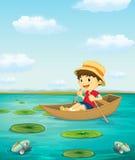 Boy on boat Stock Image