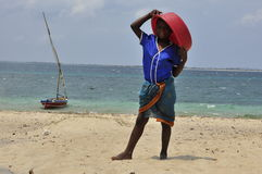 Boy with boat on the island in Mozambique Stock Photo