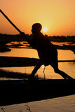 Boy on a boat on the Niger river Stock Images