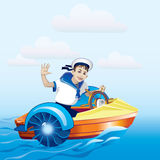 Boy in a Boat. Boy riding in a boat. Water amusement. Boat trip Stock Photography