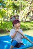 The boy boating in the park. royalty free stock images
