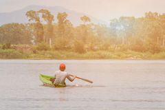 Boy boating in river in middle day. Stock Images