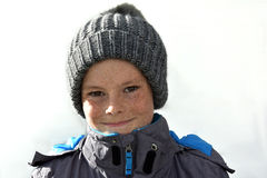 Boy with bobble hat Stock Image