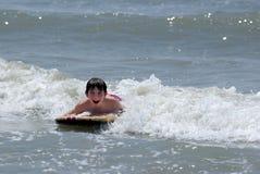 Boy on body board Stock Photos