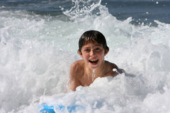 Boy body surfing. In the sea royalty free stock images