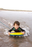 Boy Bodyboarding Stock Photography