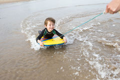 Boy Bodyboarding Stock Photos
