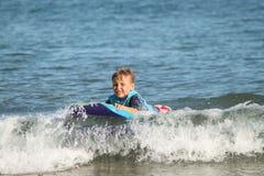 Boy Boggie Boarder Stock Image