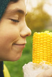 Boy and boiled gold corn Royalty Free Stock Images