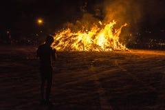 Boy on a bonfire on a beach at night, Costa Brava, Spain Royalty Free Stock Photography
