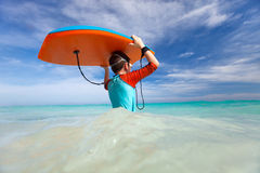 Boy with boogie board. Little boy on vacation having fun swimming on boogie board stock images