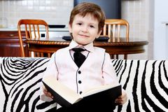 Boy with a book Stock Image