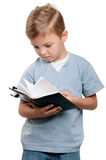 Boy with book Stock Photos
