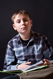 Boy with a book Stock Images