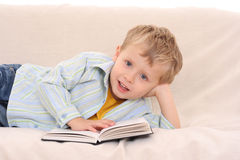 Boy and book Royalty Free Stock Photos