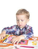 Boy with book Stock Images