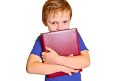 Boy with a book. Young boy holding a book isolated on white Royalty Free Stock Photo