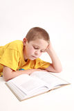 Boy and book Stock Images