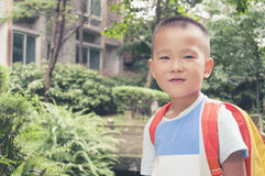 Boy with book bag Stock Image