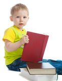 Boy with book in hands Stock Image