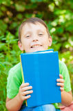 The boy with the book in hands Royalty Free Stock Photography
