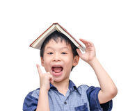 Boy with book on head thinking Stock Photography