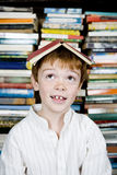 Boy with book on his head Royalty Free Stock Photo