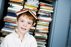 Boy with book on his head Royalty Free Stock Photography
