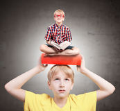 Boy with a book on his head Royalty Free Stock Photo