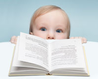 Boy and book Stock Photos