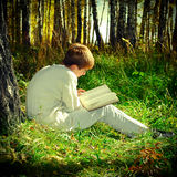 Boy with the Book outdoor Royalty Free Stock Photos