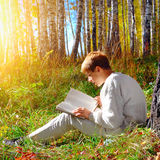 Boy with the Book outdoor Stock Image