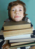 Boy with book pile close up photo Stock Photography
