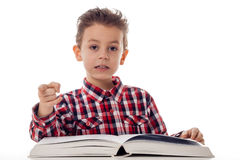 Boy with book pointing Royalty Free Stock Image