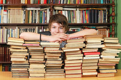 Boy and books Royalty Free Stock Images