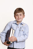 Boy with books. Could be used for studies, student, library, schoolboy royalty free stock photography
