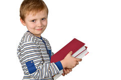 Boy with books. Young boy holding books isolated on white Stock Photo