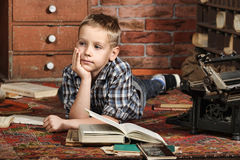 Boy with a books Stock Images