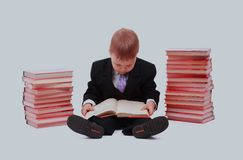 Boy with books for an education portrait - isolated over a white background. Stock Photos